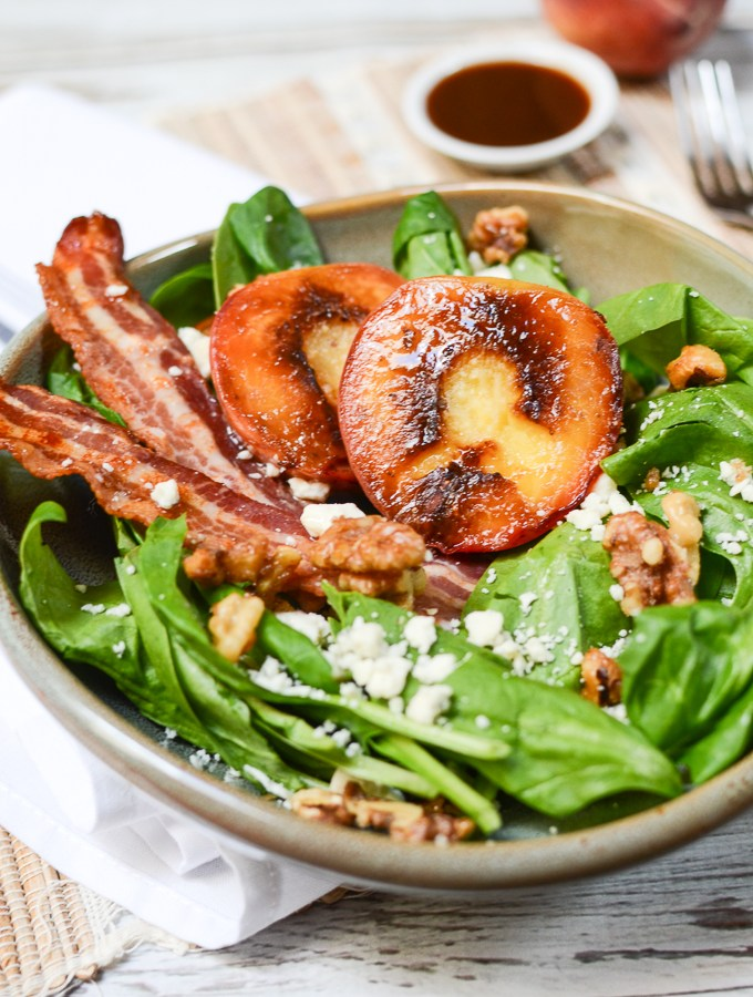 Tangy blue cheese, salty bacon, and candied walnuts will have you going back for seconds of this Grilled Peach Salad with Blue Cheese and Bacon. | theeverykitchen.com