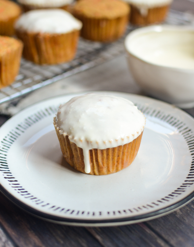My recipe for Whole Wheat Carrot Muffins with Pineapple Cream Cheese Glaze is nutritious enough for a quick addition to breakfast, but glazed enough for an afternoon sweet treat! #wholewheatbaking #muffinrecipes | theeverykitchen.com