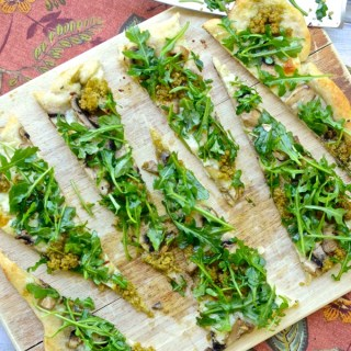 This recipe for Mushroom Pesto Arugula Flatbread takes just 20 minutes if you use a Pillsbury Crust, which means you can have a light spring dinner on the table any night of the week! It's so delicious, you'll still devour it in half the time it took to make.   theeverykitchen.com