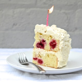 Raspberry Greek Yogurt Cake with Lemon Buttercream is tart and tangy, a bit sweet, a little gooey and it's the smoothest, glossiest frosting I've ever seen. | theeverykitchen.com