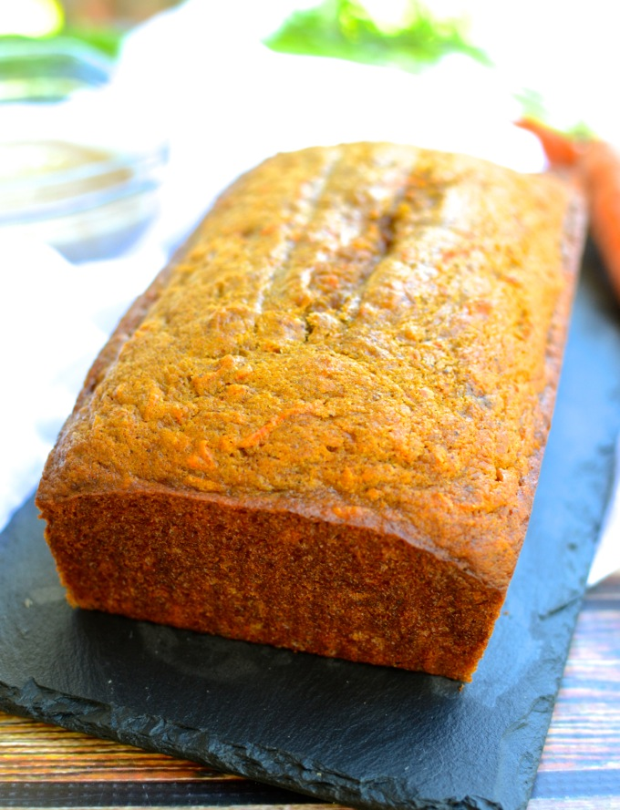 Carrot-Pumpkin Bread with Cider Glaze will make you dream of sitting on the porch with leaves falling all around and a cup of hot cider in your hand. | theeverykitchen.com