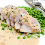 Pork Tenderloin in Spiked Cider Cream Sauce is an easy weeknight dinner recipe. You'll want to spoon the herbacious and malty sauce over everything. | theeverykitchen.com