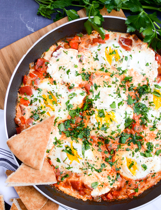 This Red Pepper Shakshuka with Goat Cheese recipe will make you a breakfast-all-day kind of person. Rich in flavor, easy to make, and good for you too! Healthy, sugar free, and gluten free. | theeverykitchen.com