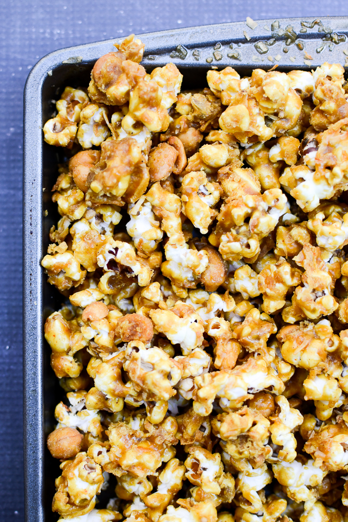 This recipe for Coconut Curry Caramel Corn will fill that sweet & salty place in your heart with candied peanuts and a soft zing of spices. | theeverykitchen.com
