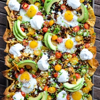 Huevos Rancheros Breakfast Nachos are dolloped with Dean's DairyPure Sour Cream. AD. This quick and easy recipe will have the family fighting for leftovers! | theeverykitchen.com