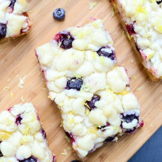 Lemon Blueberry Shortbread Bars are bursting with luscious lemon curd and juicy blueberries. This recipe will be the star of all of your summer parties.   theeverykitchen.com