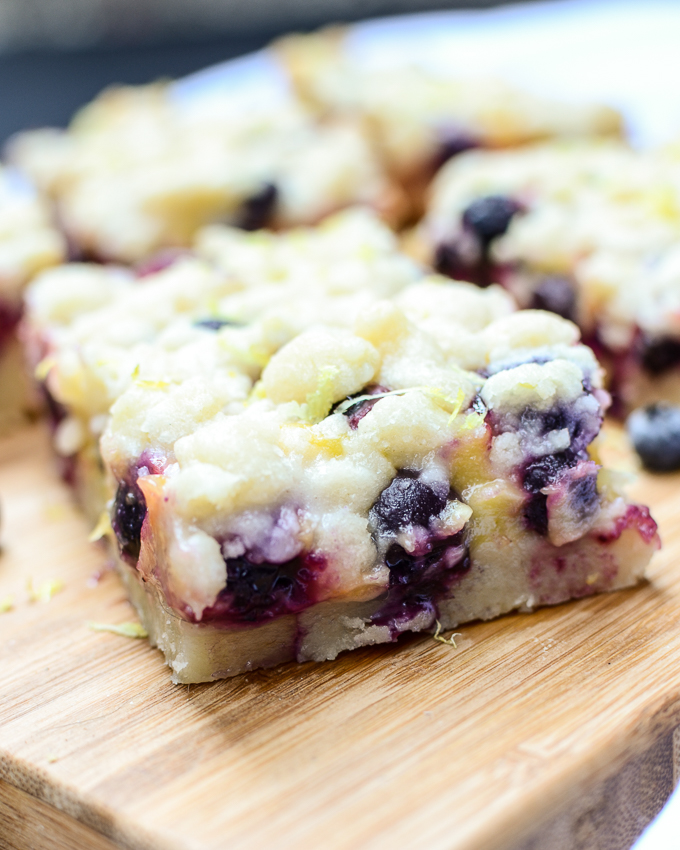 Lemon Blueberry Shortbread Bars are bursting with luscious lemon curd and juicy blueberries. This recipe will be the star of all of your summer parties. | theeverykitchen.com