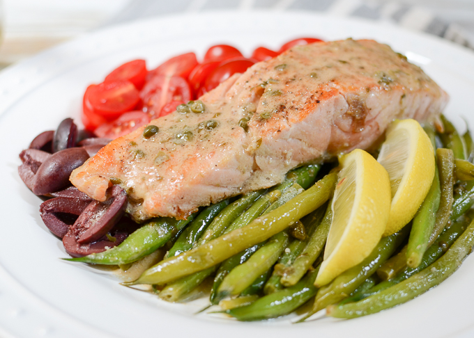 """Salmon Nicoise Salad with Dijon Caper Dressing tastes like a """"treat yourself"""" meal, but it's gluten free, sugar free, low-carb, paleo-friendly, and deceptively easy to prepare. 