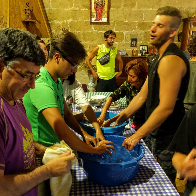 Communal post-dinner dishwashing in an albergue, Camino de Santiago | theeverykitchen.com