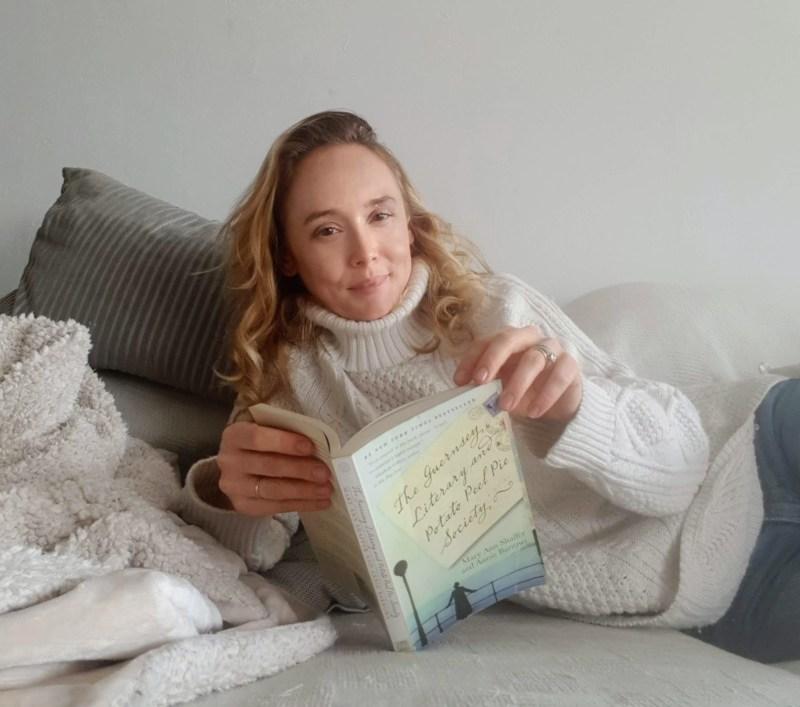 woman reading The Guernsey Literary and Potato Peel Society