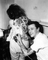 1950s Photo of Rockabilly Bad Boy Giving His Girlfriend A Back Story - Rebel Style - Fashion Inspiration