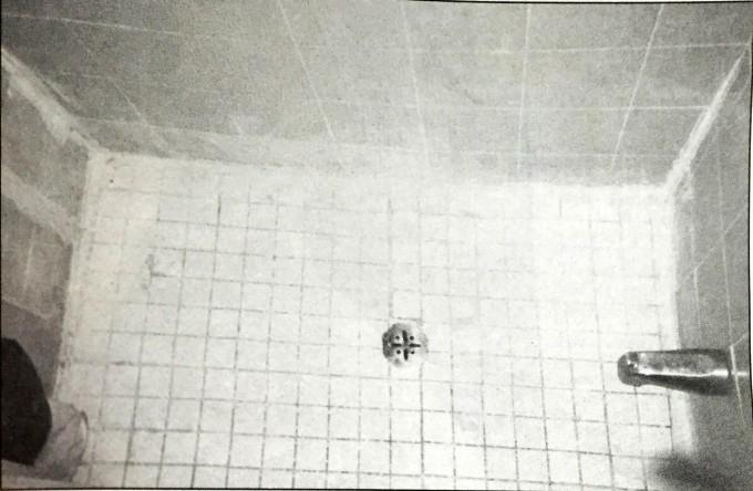This nasty, cramped shower stall had actually been repaired only two months prior. The handyman stuck cocking over the existing tiles where grout and scum had been building up for much too long. Photo: Lora Markova