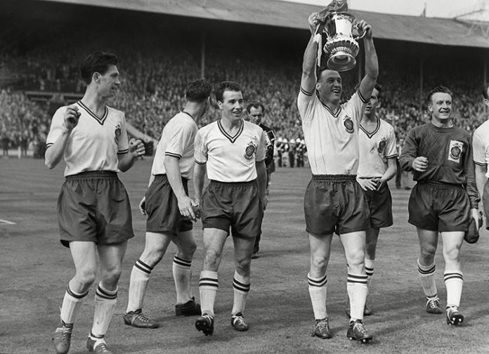 Bolton Wanderers captain Nat Lofthouse holds the Cup aloft after firing his side to victory over Manchester United in 1958.