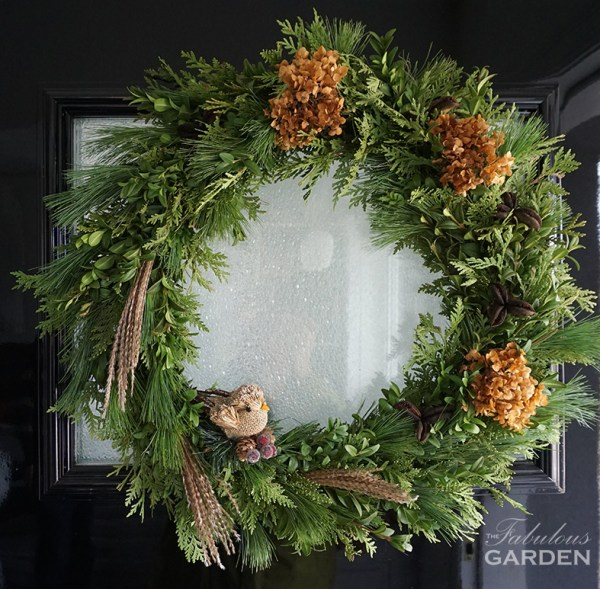 Wreath with natural elements and bird