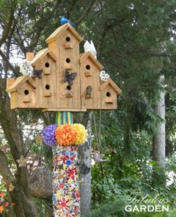 birdhouse on mosaiced pole