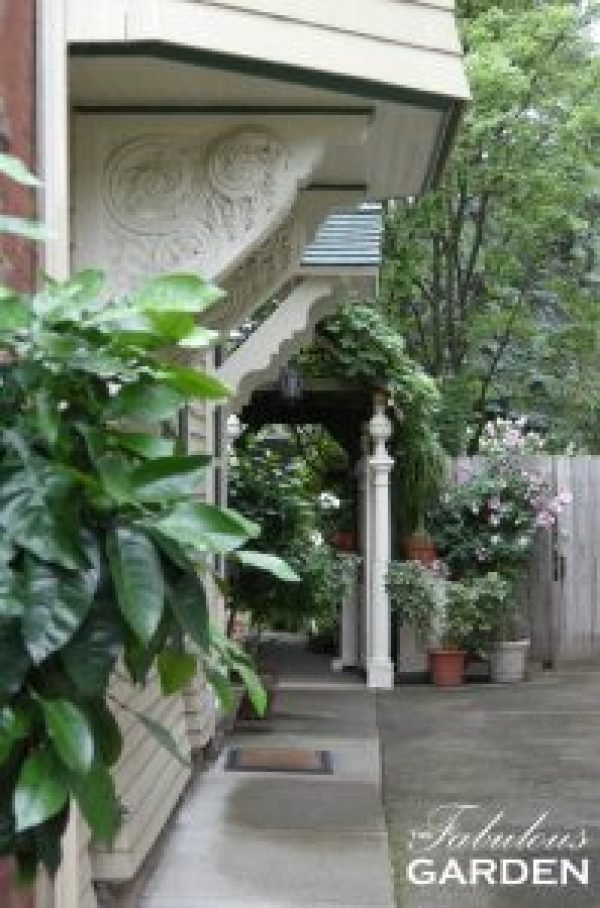 Decorative brackets and pillars frame the entrance to this garden