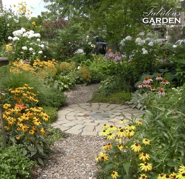Stone circle creates a focal point in this English style garden