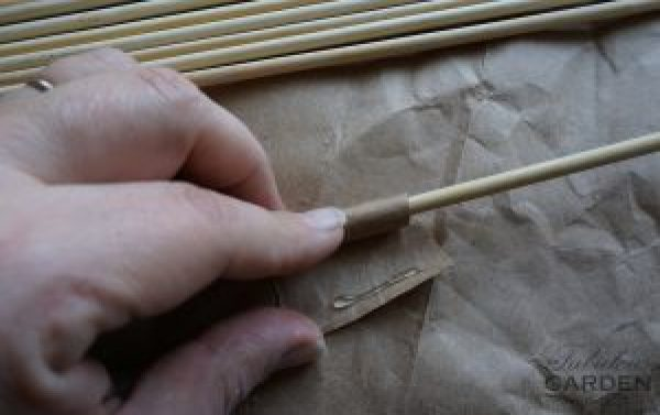 Wrap end of skewer with paper to make it thicker