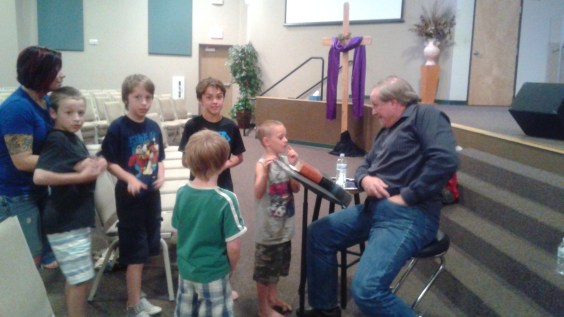 Our pastor with his little flock of young men. <3