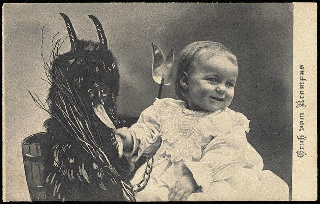 An old photo on a Christmas card with Krampus.
