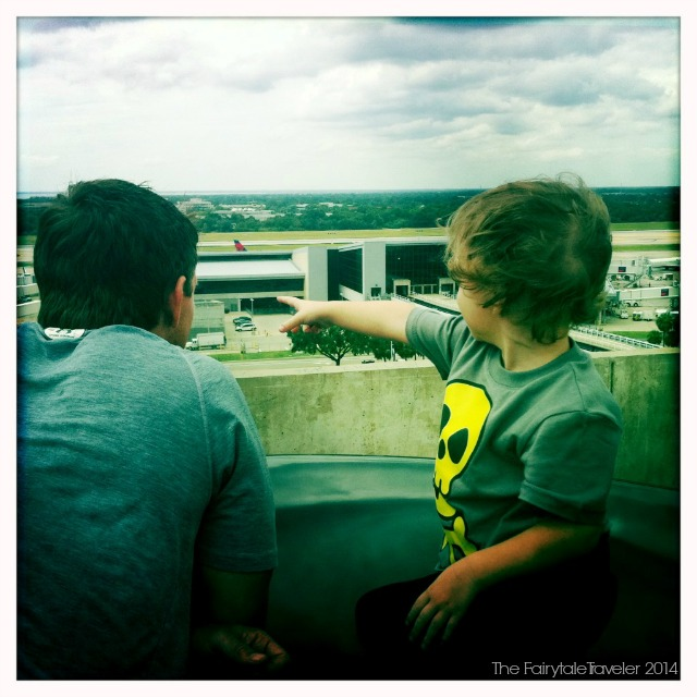 Kids love the airport. The Little Fairytale Traveler and bugs are watching the planes take off from the roof of the parking garage.