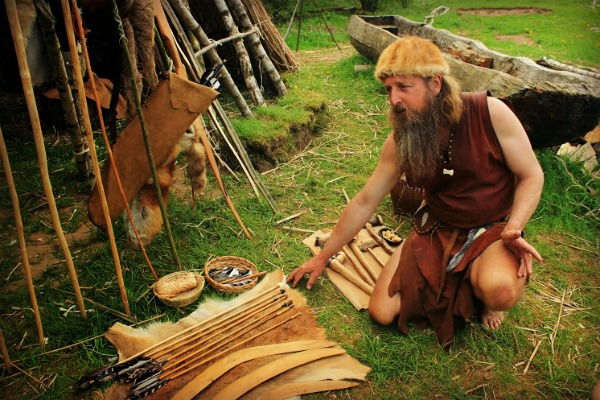 Showing different Neolithic weapons at the Stone Age Park.