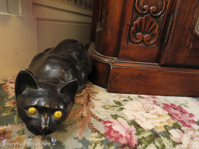 A weird black cat in the guest room where the murder of Abbey Borden occurred photo by Christa Thompson