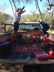 Grant and Cora stomping down our kindling for more space.