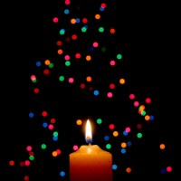 Candle and Christmas Tree by Lois Elling at Flickr