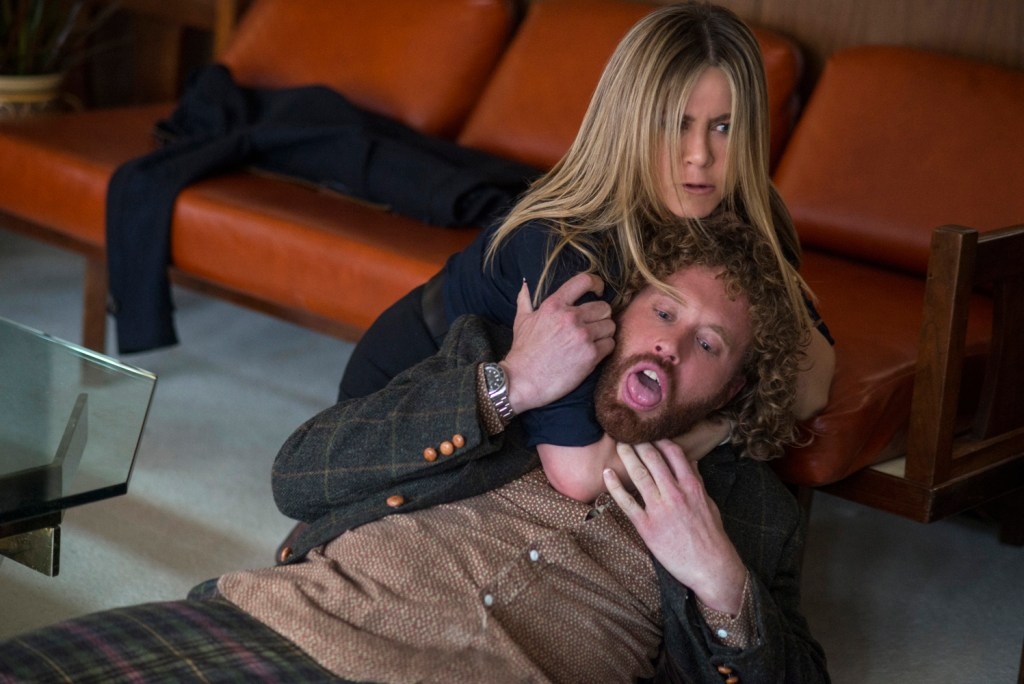 Jennifer Aniston as Carol Vanstone and T.J. Miller as Clay Vanstone in OFFICE CHRISTMAS PARTY by Paramount Pictures, DreamWorks Pictures, and Reliance Entertainment
