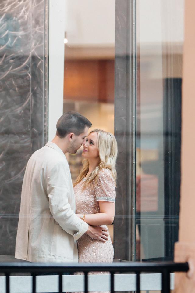 Glass Elevator Engagement Photo