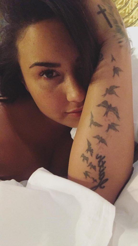 Demi Lovato Flashes A Nipple In Bed (4 Pics + Gif)