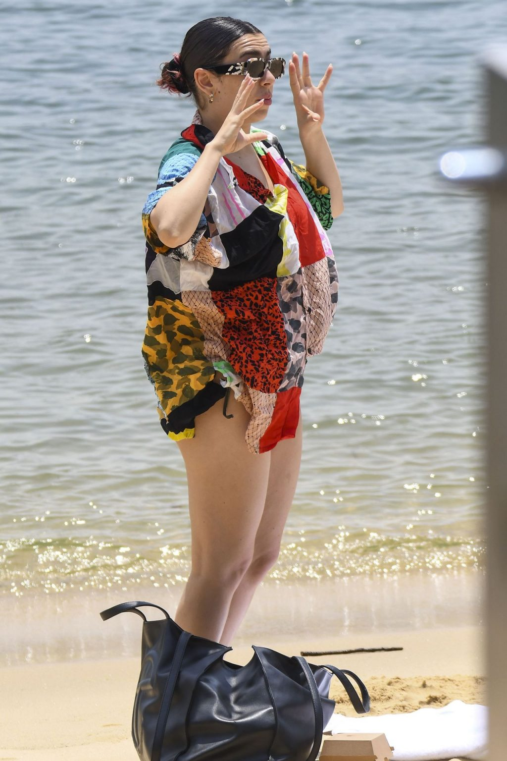 Charli XCX Spotted Cooling Off At A Sydney Beach (26 Photos)