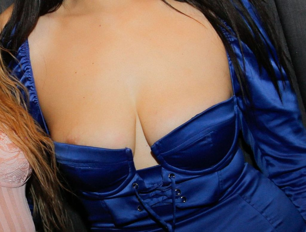 Amel Rachedi's Areola Peek (4 Photos)