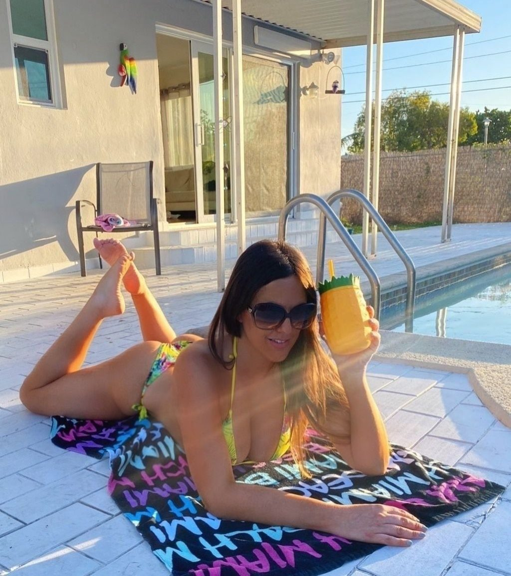 Claudia Romani Sunbathes by the Pool in Coral Gables (9 Photos)