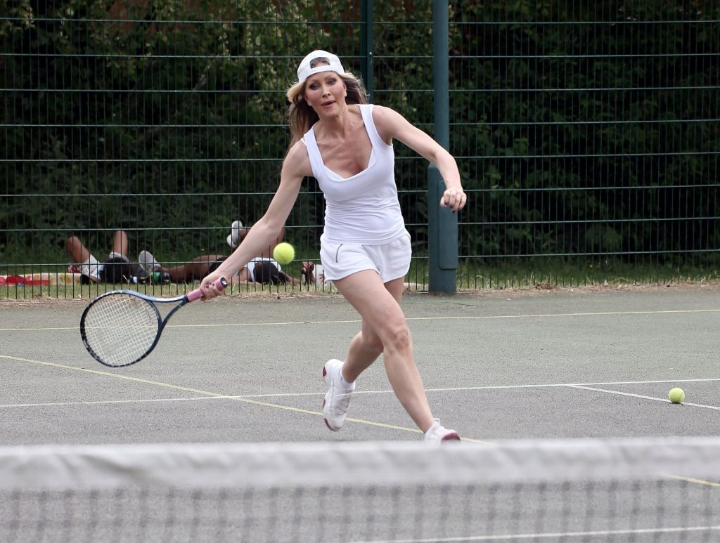 Model Caprice Works Up a Sweat as She Plays a Game of Tennis (13 Photos)