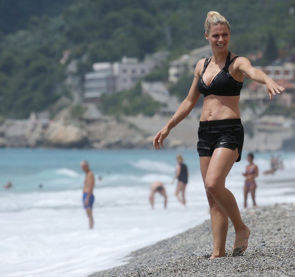 Michelle Hunziker Shows Off Her Sexy Body on the Beach (16 Photos)