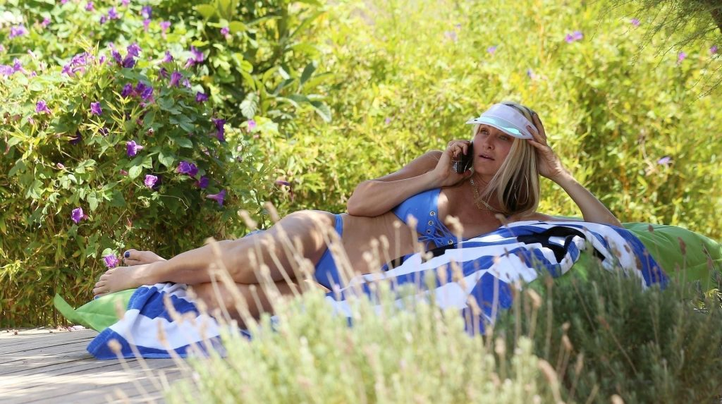 Caprice Shows Off Her Toned Figure while Relaxing Poolside in Ibiza (24 Photos)