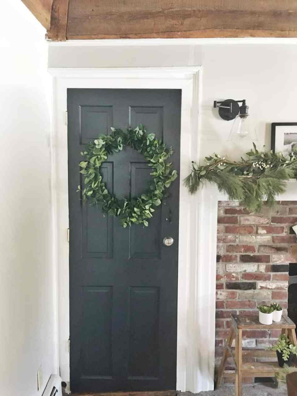 The Eucalyptus wreath on a grey door in the house.