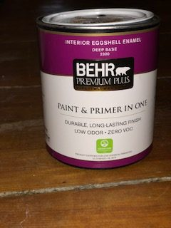 A can of Behr paint on the table.