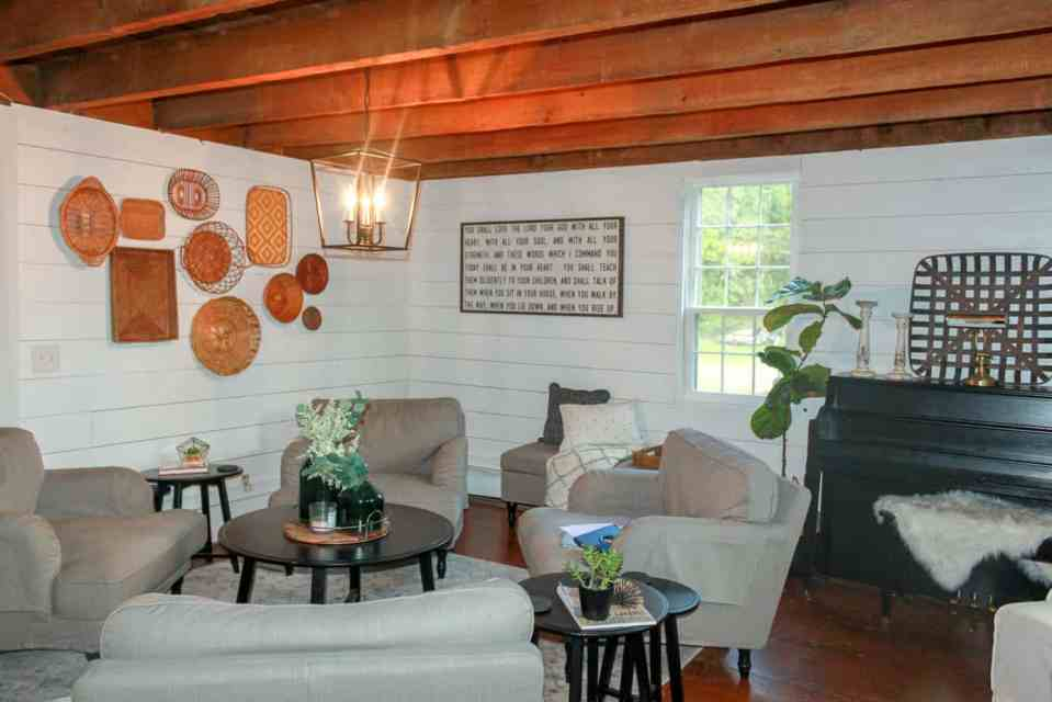 A light fixture is in front of the baskets in the living room.