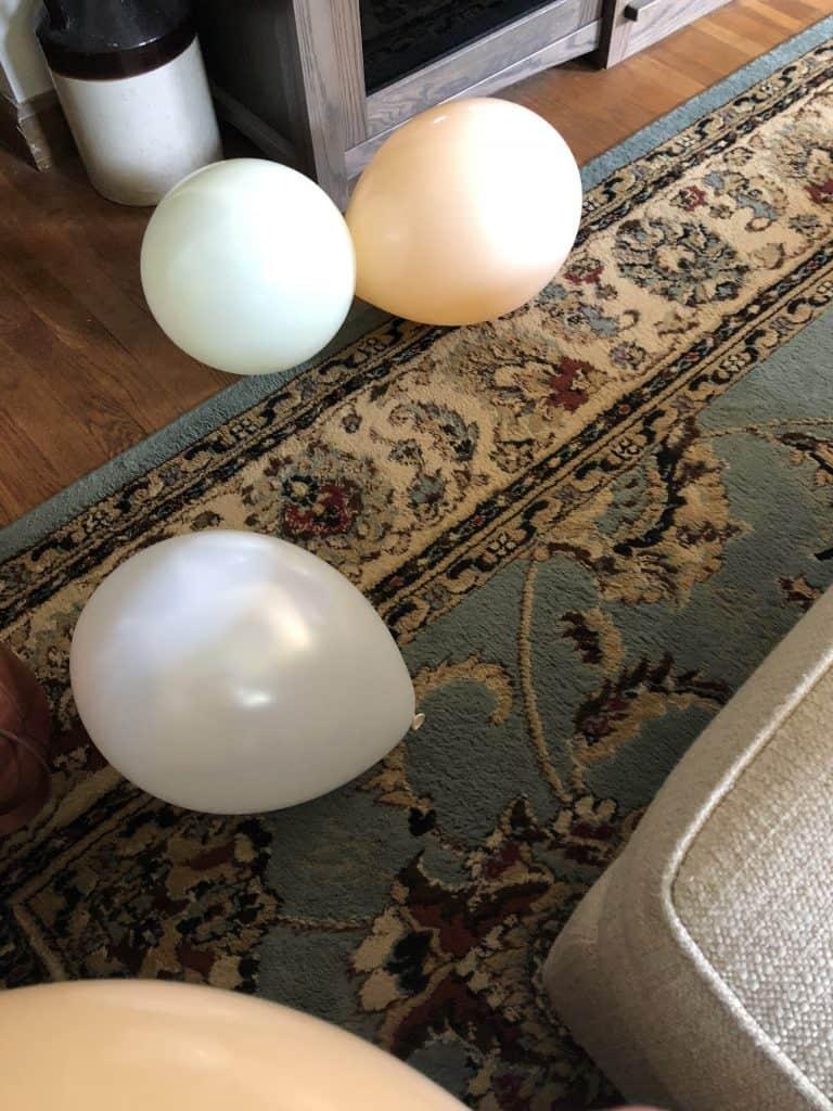 Blown up balloons on the floor.