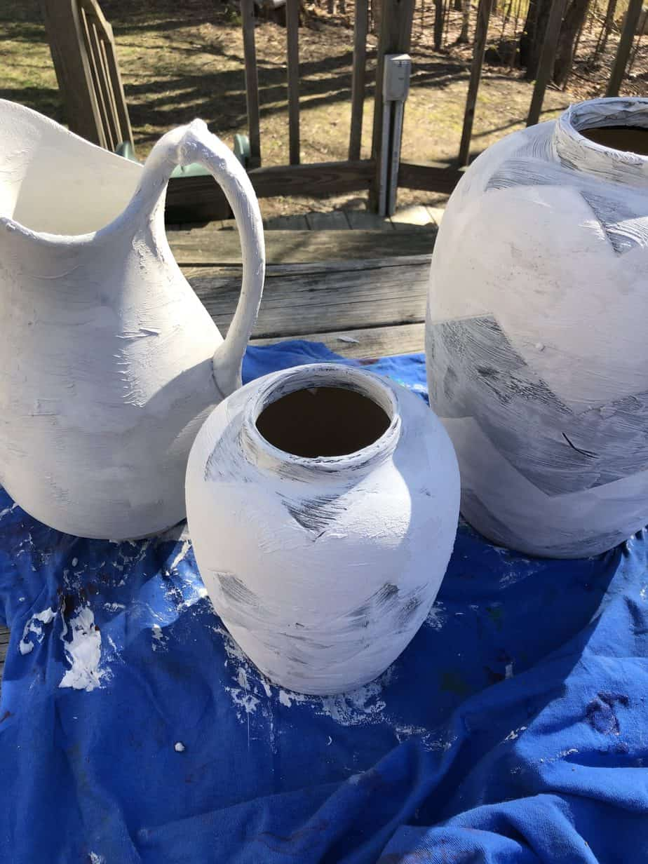 Vases painted over with spackle.