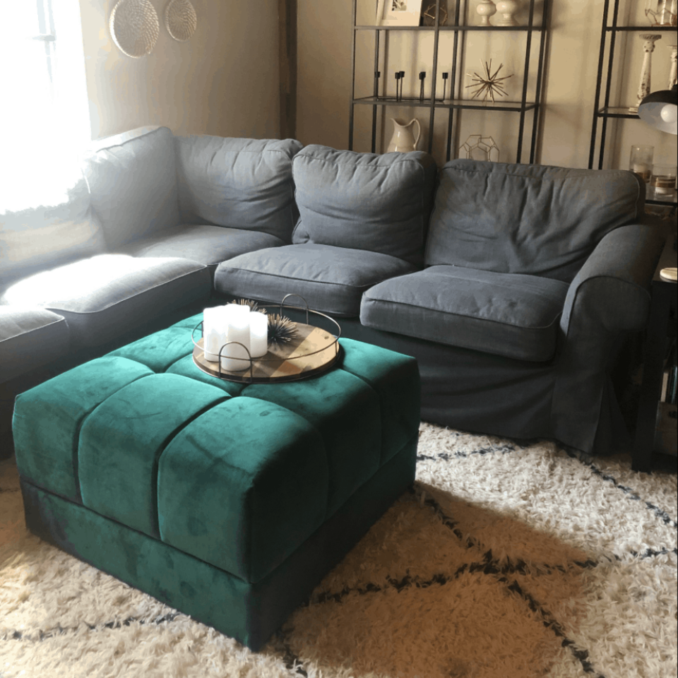 Gray Ikea sectional couch that is worn.