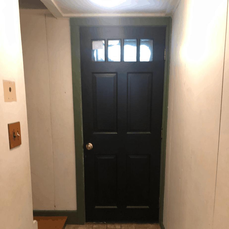 black door why green trim in an entryway