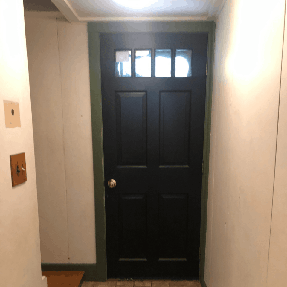 black door why green trim in an entryway