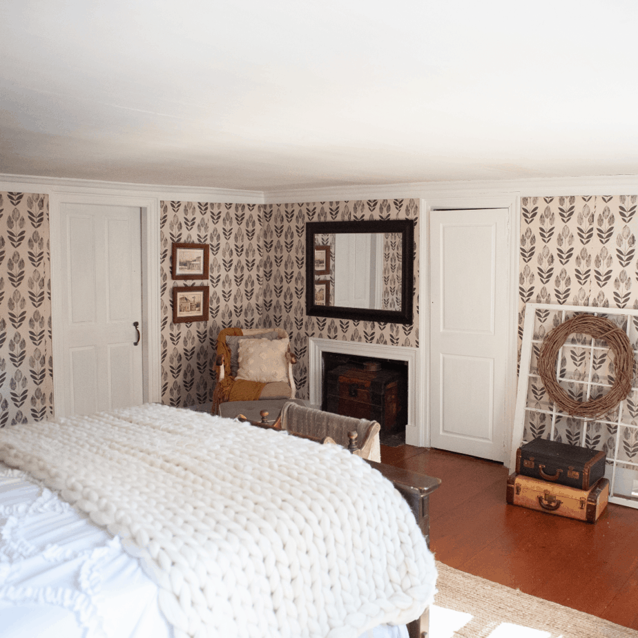 Fire place and rocking chair in bedroom corner.