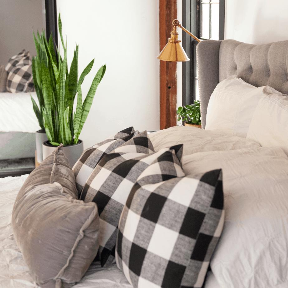 Buffalo check pillows on the bed.