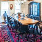 red dining room rug with wooden table
