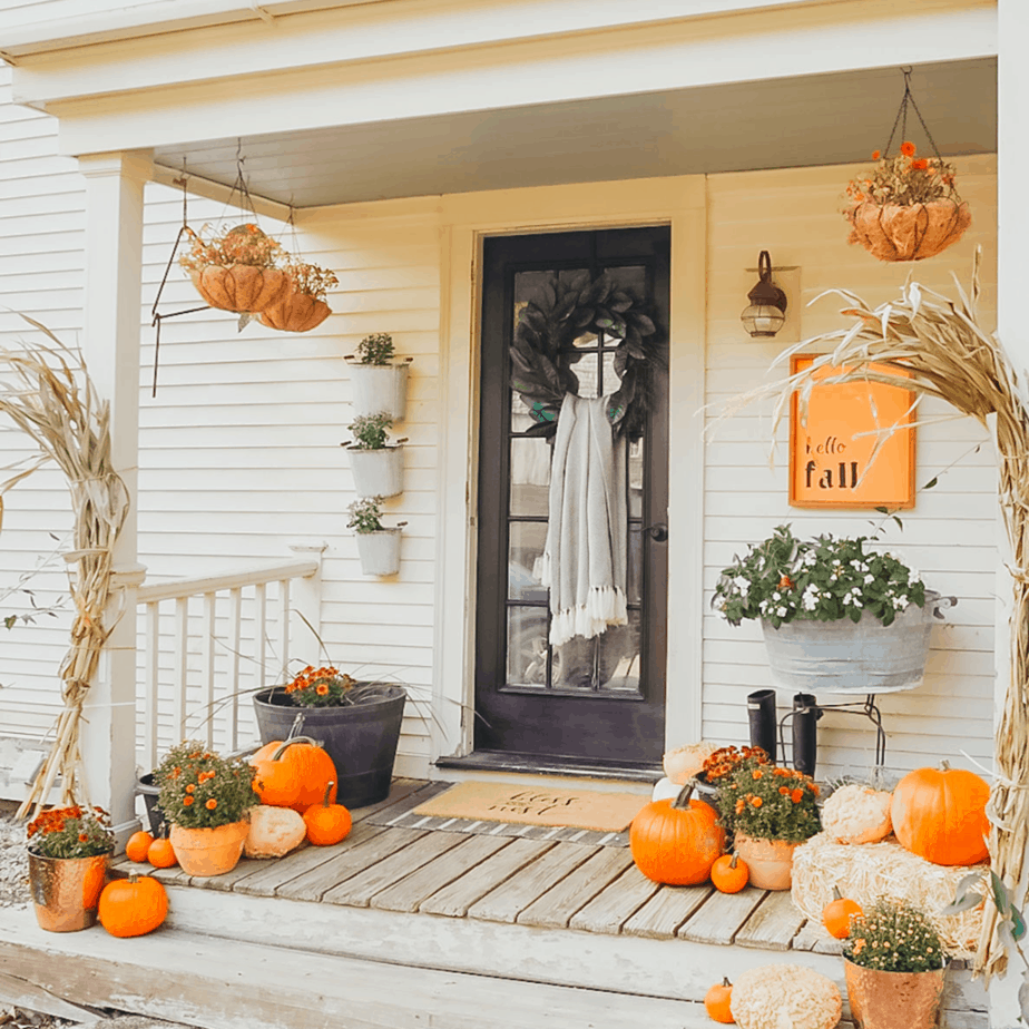 wall of planters on front porch with fall decor